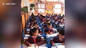 Chinese school installs bars over desks to help correct pupils' posture when handwriting [Video]