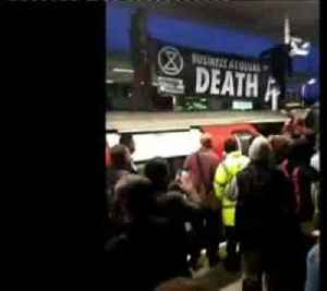 Commuters fight with climate change protesters as they disrupt London rail services [Video]
