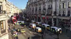 Large police presence as Extinction Rebellion block Oxford Circus with massive wooden structures [Video]