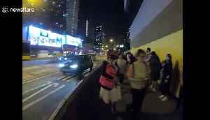 Hong Kong activists form human chain in protest of face mask ban [Video]