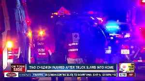 Two children injured after truck crashes into home [Video]
