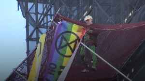 Extinction Rebellion climate protester scales Big Ben scaffolding
