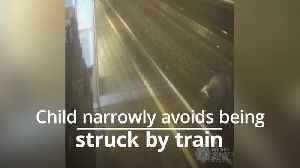 Boy narrowly avoids being hit by train [Video]