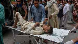 Blasts in Afghanistan mosque kill scores of worshippers [Video]