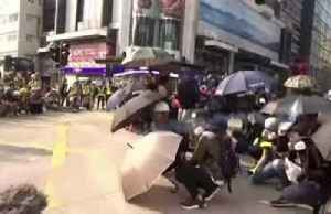 Hong Kong police and protesters exchange tear gas and petrol bombs [Video]