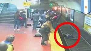 Passengers stop subway train from hitting woman on tracks [Video]