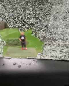 Guilty little boy smashes dad's car window with golf ball [Video]