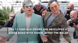 Elton John says Taron Egerton is like 'family' [Video]