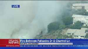Water-Dropping Helicopters Conducting An Aerial Assault On Pacific Palisades Brush Fire [Video]