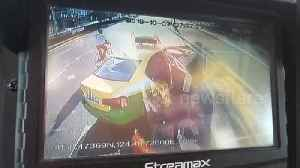 Bus deliberately crashes into taxi which blocks its way after driver was encouraged by passengers [Video]