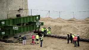 News video: Lighthouse shuffled away from coast to stop it falling into Danish sea