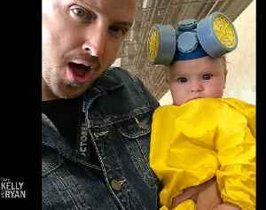 "Aaron Paul Dressed His Baby in a ""Breaking Bad"" Costume at Comic Con [Video]"
