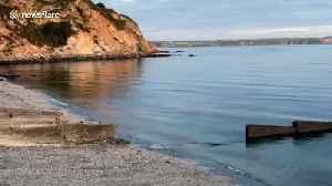 UK harbor from historical drama series, Poldark, left in a sea of orange poo [Video]
