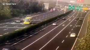 Transport truck flips over trying to avoid stalled car on Chinese highway [Video]