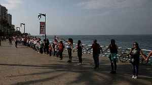 Demonstrators in Lebanon form human chain across Lebanon [Video]
