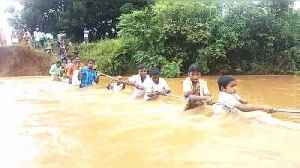 Children risk lives to cross flooded river just to get to school [Video]