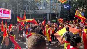 Thousands of pro-Spain supporters take to streets of Barcelona after separatist clashes [Video]