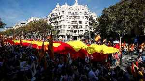 Thousands march for Spanish unity in Barcelona one day after violent pro-independence protests [Video]