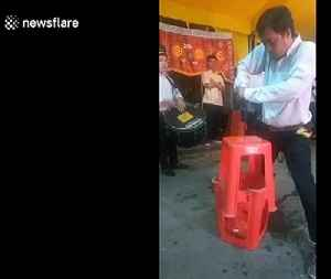 Man uses electric drill to pierce his nose at show in Vietnam [Video]