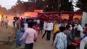 Explosions as huge blaze tears through makeshift firecracker shops in north India [Video]