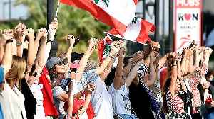 Lebanon protesters form human chain across the country [Video]