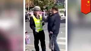 Old man slaps cop in the face [Video]