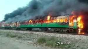 At least 65 killed in Pakistan train fire [Video]