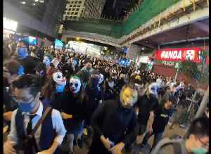 News video: Halloween in Hong Kong is a monster mash-up of protesters in costume and riot police firing tear gas