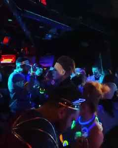 Dedicated party-goer stays in character during Halloween rave [Video]