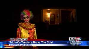Trick-or-treaters brave the cold [Video]