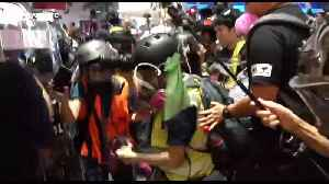 Hong Kong police shove to floor and pepper spray journalists [Video]