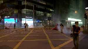 News video: Hong Kong protesters set barricade on fire after police fire tear gas