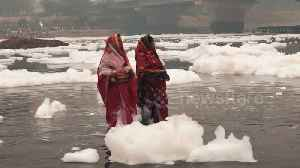 Hindus perform religious ceremony in sacred river covered in toxic foam [Video]