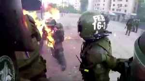 Chile police officers catch fire during protests [Video]
