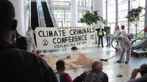 News video: Climate activists stage 'oil spill' at Africa Oil Week conference in Cape Town