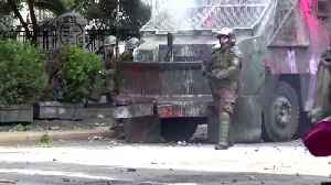 Protesters clash with armored police trucks in Chile [Video]