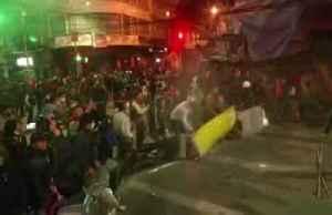 Tear gas streams through the streets of La Paz [Video]