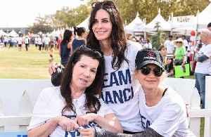 Courteney Cox and Renee Zellweger support Nanci Ryder at ALS walk [Video]