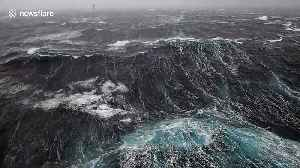 Disorientating footage shows waves crashing against oil rig in North Sea storm [Video]