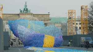 News video: The Berlin Wall broke a city in two. 30 years after it fell, a floating sculpture celebrates unity