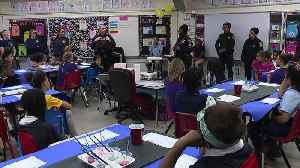 Woman in law enforcement talk to girls at Cleveland school [Video]