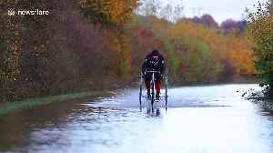 Man on TRICYCLE tackles floods in West Yorkshire, England [Video]