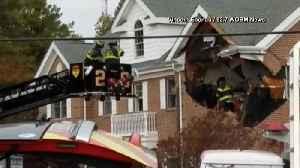 2 dead after Porsche crashes into building's 2nd floor [Video]