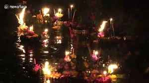 Serene scene during Buddhist ceremony for water goddess in Thailand [Video]