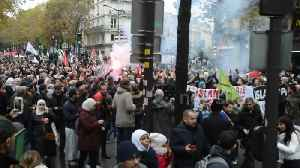 Parisians demonstrate against Islamophobia after far-right politician asked woman to remove veil [Video]