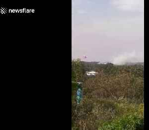 Plane drops fire-retardant on bushfires in Sydney outskirts [Video]