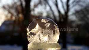 Frosty weather in Canada freezes soap bubble solid in mesmerising video [Video]