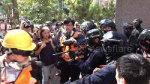 News video: Hong Kong police shoot protesters with pepper spray pellet gun a near point-blank range