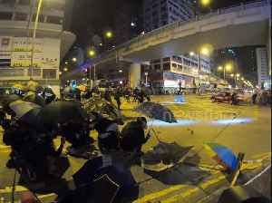 Tensions flare as protestors and police clash at Hong Kong's Mongkok police station [Video]