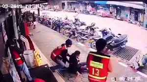 Thai woman survives after 22,000 volt power line falls on her outside grocery shop [Video]